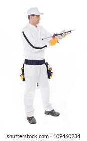 construction worker in white overalls holding a gun with silicon
