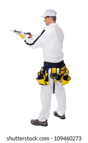 construction worker in white overalls holding a gun silicone sea