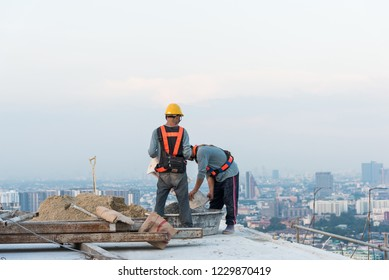 Construction worker is working on high building, bangkok, thailand