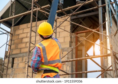 Construction worker are working on scaffolding and wearing safety harness for safety working at construction site.
