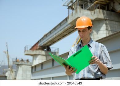 Construction worker.Construction of the railway bridge.