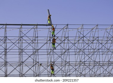 Construction workers building a frame