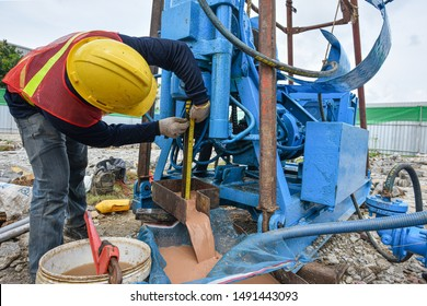 Construction workers checking deep for drilling soil samples field for  construction site works.