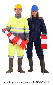 Construction workers with cones