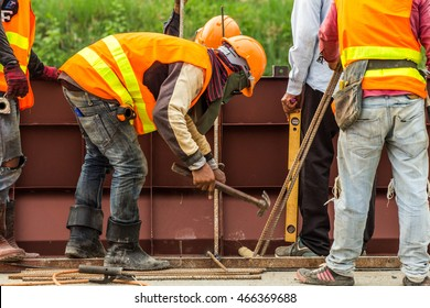 construction workers discussing about work plan construction site