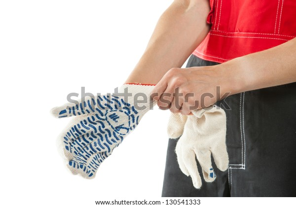 Construction worker's hands in gauntlets, isolated on white