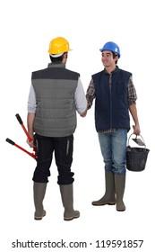 Construction workers handshaking