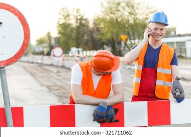 Construction workers have a break for a call