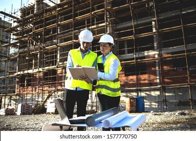 Construction workers having work meeting