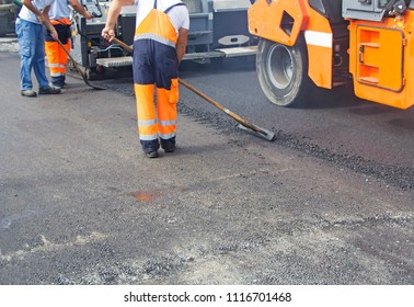 Construction workers on asphalting and road repair