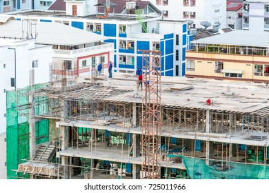 Construction Workers On the Building in Construction Site