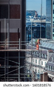 Construction workers on a high scaffold on a building site in central London, UK