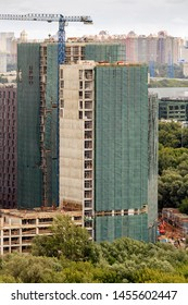 Construction workers on scaffold. Scaffolding staging is temporary structure support work. Tall building under construction scaffolds.  construction site. building facade with scaffolding. apartment