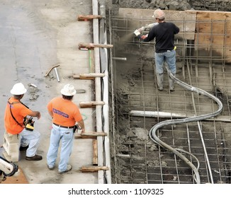 Construction workers pumping cement in Honolulu Hawaii.