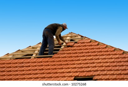 construction workers reapiring roof