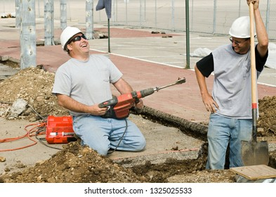 Construction workers sharing a lighthearted moment while working.