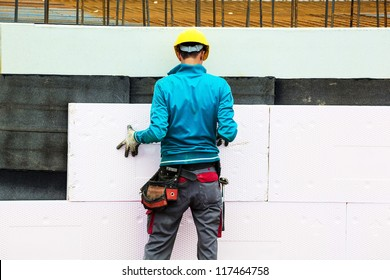 construction workers at a construction site when the building insulation