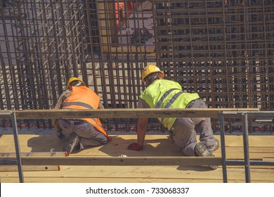 Ironworker Workers Working On Concrete Reinforcements Stock Photo