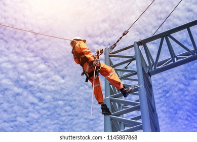 Construction workers wearing safety harness belt during training at high place, Construction workers tying  on road construction structure with on blue sky background
