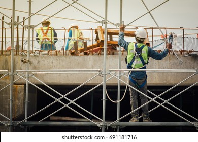 Construction workers working on scaffolding, Man Working on the Working at height  at construction site.copy space.