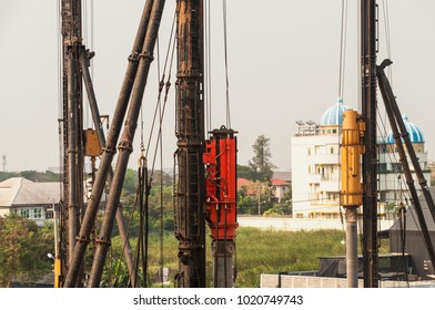 Construction  working on a construction site on high ground heavy industry and safety concept over  natural background sunset