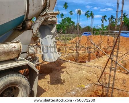 Construction Work Placing Concrete Foundations Pouring