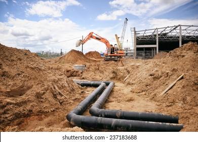 Bauarbeiten, Baumaschinen, Bulldozer, Grabungen, Fabrik