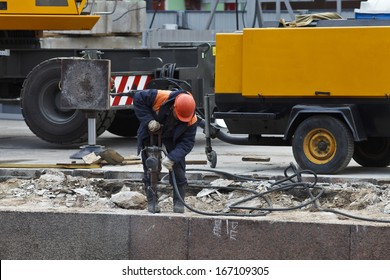 Construction works on the embankment by means of a jackhammer