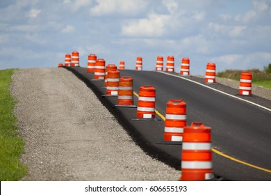 Construction zone on a newly paved road.