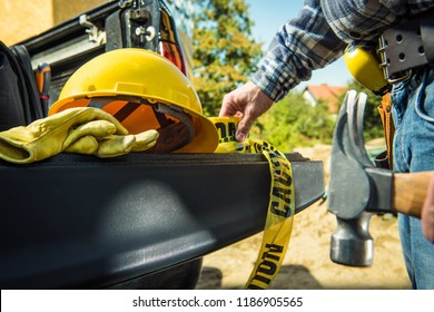 Construction Zone Safety Equipment. Yellow Hard Hat, Caution Tape and Safety Gloves. Contractor Worker Preparing For His Job.