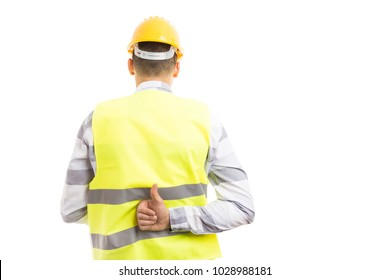 Constructor or builder showing like thumbs-up gesture behind back isolated on white studio background