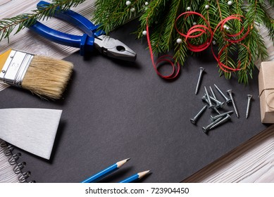 Constructor tools and black notebook, Christmas concept