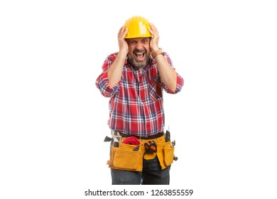 Constructor touching head with yellow safety hardhat as exasperated gesture having panicked expression isolated on white