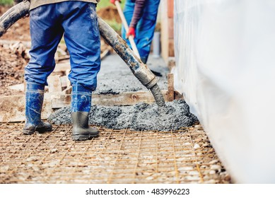 Constuction details - worker laying cement or concrete with automatic pump