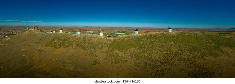 Consuegra castle and windmills aerial view with blue sky in La Mancha Spain famous Don Quixote site