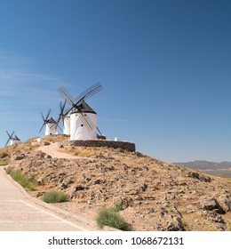 CONSUEGRA, SPAIN - CIRCA AUGUST 2017: Group of windmills in a hill at the Consuegra, La Mancha, Spain, Europe