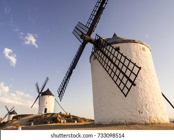 CONSUEGRA, SPAIN - JULY 29, 2017: Windmills (molinos) in Consuegra, Toledo Province, Castilla La Mancha, Spain, at sunset.