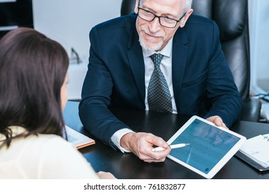 Consultant advising young woman at office