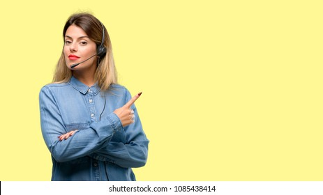 Consultant of call center woman in headphones pointing away side with finger