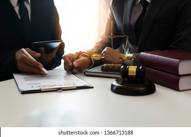 Consultation of Businessman or lawyer team meeting with client, Law and Legal services concept, Good service cooperation, Hands using tablet and laptop.