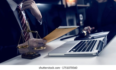 Consultation of Businessman or lawyer team meeting with client, Law and Legal services concept, Good service cooperation, Hands using tablet and laptop. selective focus.