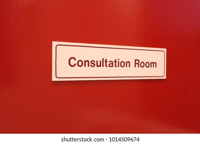 Consultation Room sign on red door