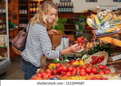 consumer buying food in supermarket