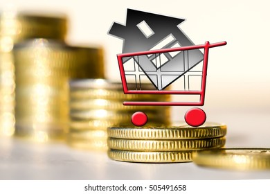 Consumer cart and house on a background of money . The concept of mortgage lending .