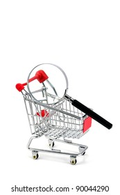 Consumer protection concept. Magnifying glass & shopping trolley