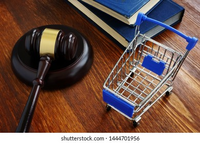 Consumer protection law concept. Shopping cart and gavel.