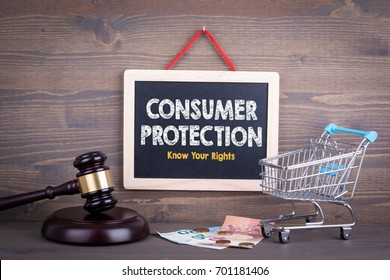 Consumer Rights Protection concept. Chalkboard on a wooden background
