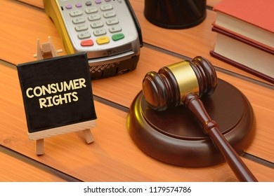 Consumer rights theme with wooden gavel on table, law background