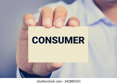 CONSUMER word on business card shown by a man