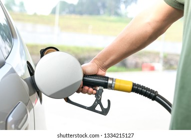 Consumerism concept : handle fuel nozzle to refuel